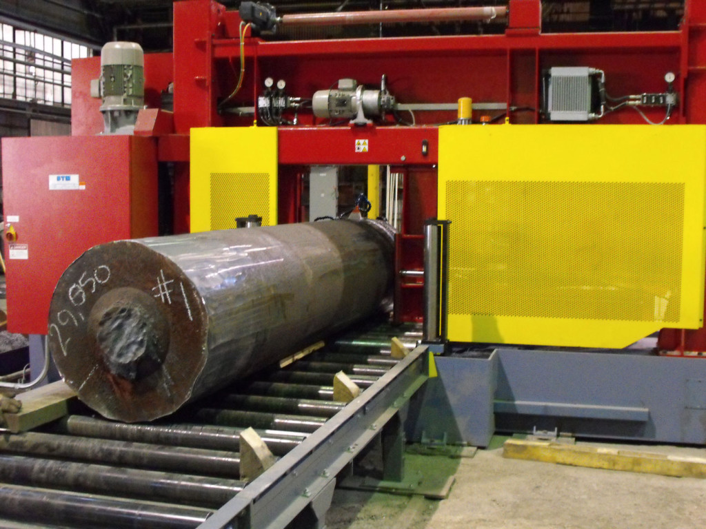 Large cylinder of metal on a conveyor belt